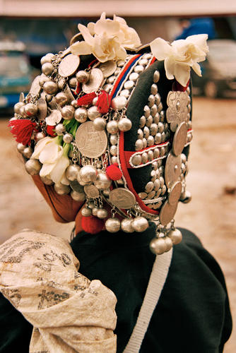Akha lady dressed in traditional headdress at the market at Muang Sing, Luang Namtha Province.