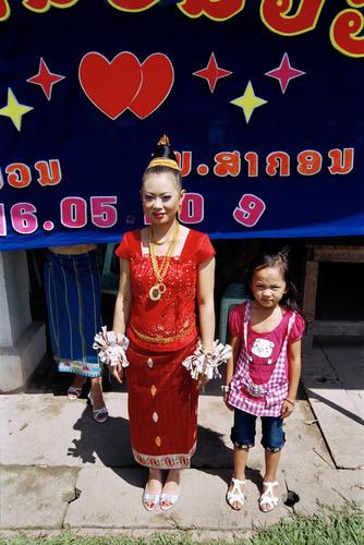 Young bride with bridesmaid at Muang Sing, Luang Namtha Province.