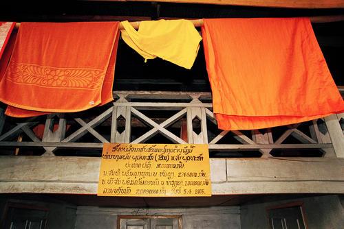 Robes hanging from a balcony at the Wat Thammothayalan temple complex, Mount Phousi, Luang Prabang.