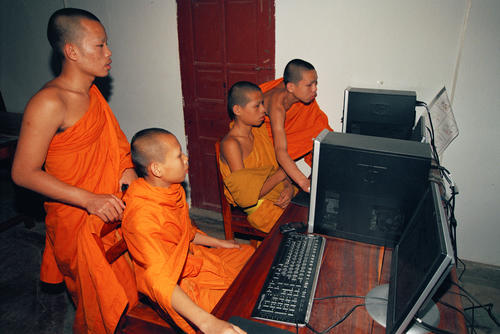 Monks at the computer centre in the Wat Thammothayalan temple complex, Mount Phousi, Luang Prabang.