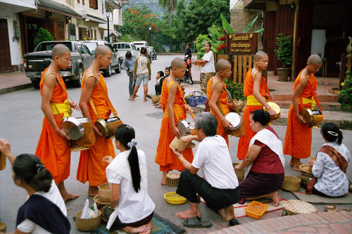 Monks collecting their early morning alms, Luang Prabang.