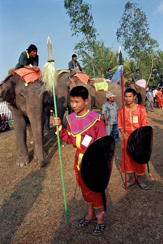 Young youths dressed in traditional battle garments at the annual Elephant Festival held in Sayaboury Province