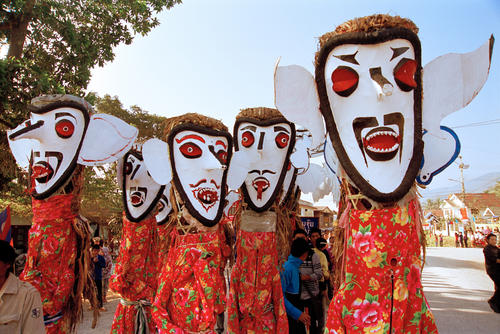Masked dancers performing in a parade at the annual Elephant Festival held in Sayaboury Province
