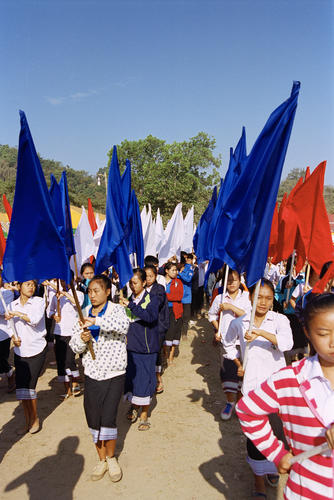 Children with flags performing in a parade at the annual Elephant Festival held in Sayaboury Province.