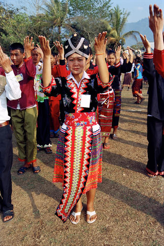 A girl in traditional Lao costume performing a traditional dance in a parade at the annual Elephant Festival held in Sayaboury Province.