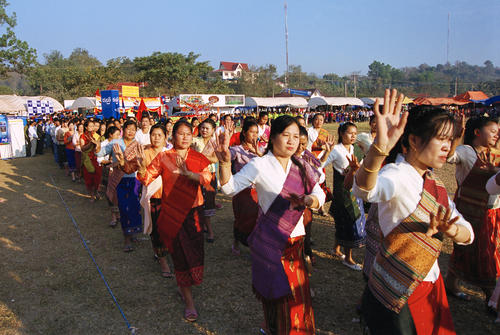 Local women performing traditional dancing in a parade at the annual Elephant Festival held in Sayaboury Province.