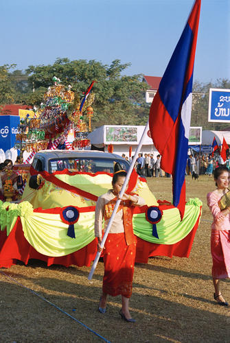 Local women performing in a parade at the annual Elephant Festival held in Sayaboury Province.