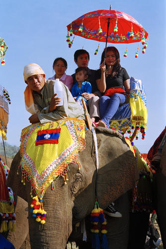People being taken on an elephant ride at the annual Elephant Festival held in Sayaboury Province.
