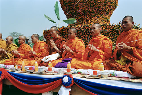 Monks offering blessings to the elephants at the annual Elephant Festival held in Sayaboury Province.