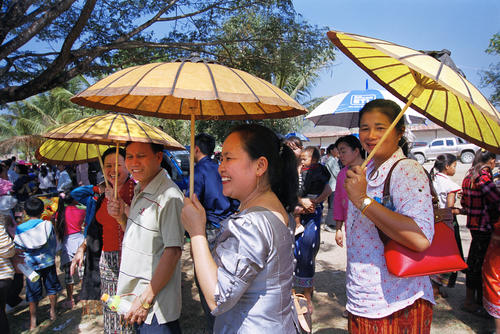 Women with coloured, handmade parasols at the annual Elephant Festival, Sayaboury Province, Laos.