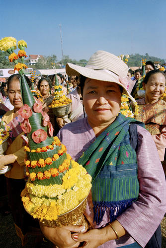 Women with floral offering at the annual Elephant Festival, Sayaboury Province, Laos.