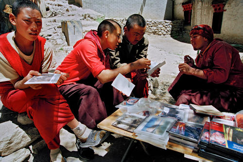 Monks at a book stall at the Hemis Gompa, Ladakh.