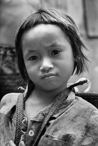 Young boy belonging to the Kachah indigenous people near Ban Lung, Ratanakiri Province, Cambodia.