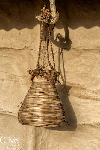 Traditional basket hanging from a Tharu house outside the Bardia National Park