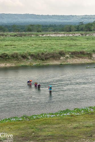 Locals crossing the Rapti River in the Chitwan National Park