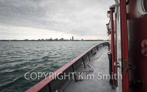 Buffalo NY shoreline, skyline, fireboat Edaward M Cotter