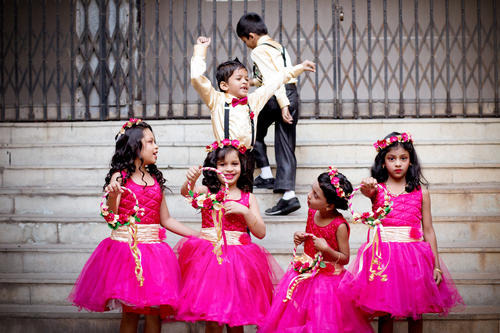 ring bearers and flower girls dancing at a catholic wedding