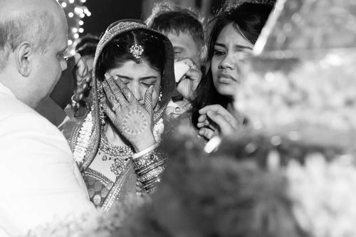 black and white bridal portrait of bride during her vidai