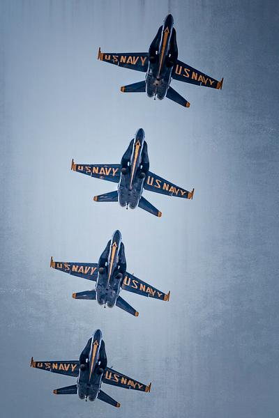 Four Blue Angels in Flight Formation