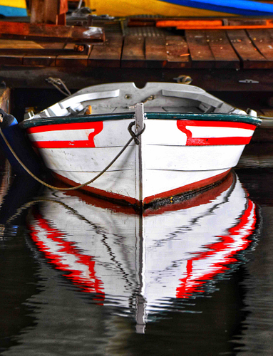 A wooden boat in Boston, red and white