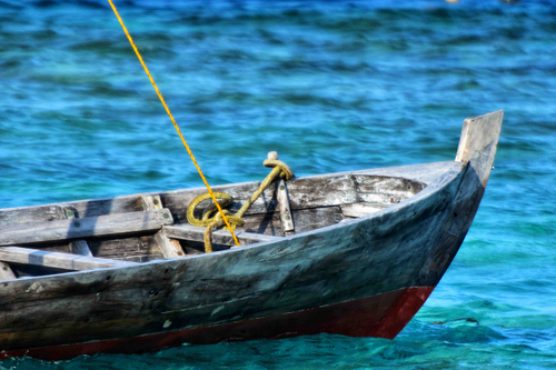The Maldives, wooden boat, blue sea, larger shot