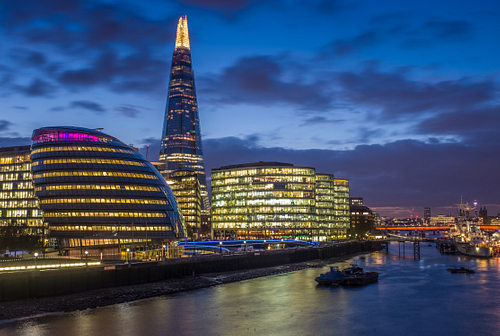 A long exposure shot of The Shard and City Hall at Night