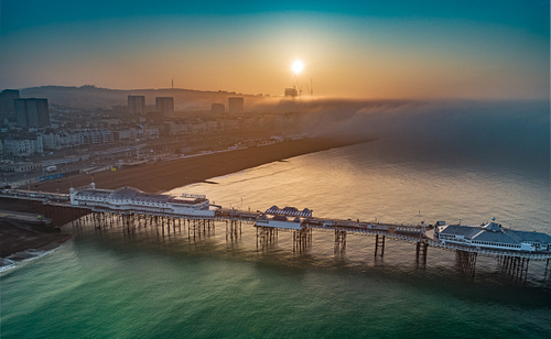Drone Image of Misty Sunrise Over Brighton Pier