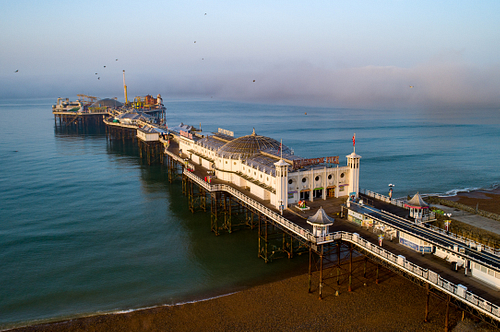 Low level drone image of the Palace Pier in Brighton, Sussex