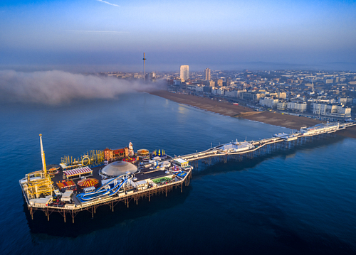 High level drone image of the Palace Pier in Brighton, Sussex