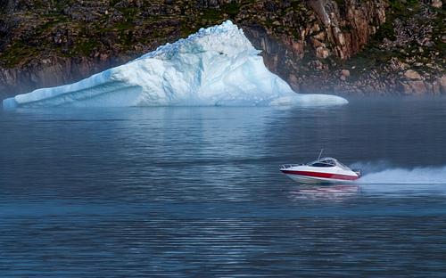 Speedboat Passes Giant Iceberg in Greenland