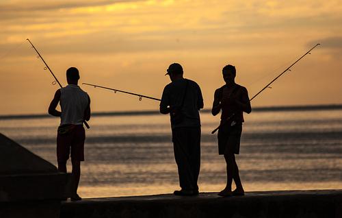 Three Cuban Fishermen in a Sunset