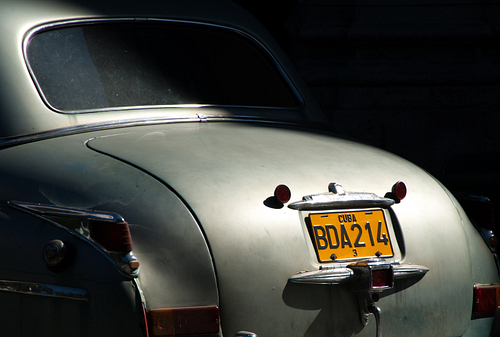 Light and shade shows the license plate of an old American class