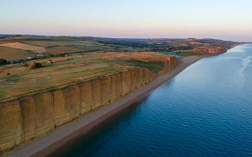 Drone image of hot of the beach and cliffs in West Bay