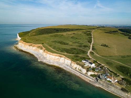 Drone image of Cuckmere Haven with coastguard cottages