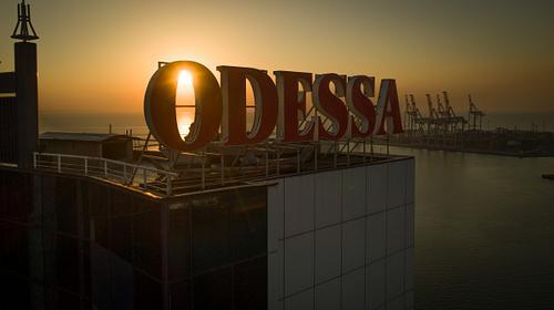 Sun rises behind large Odessa Sign Ukraine