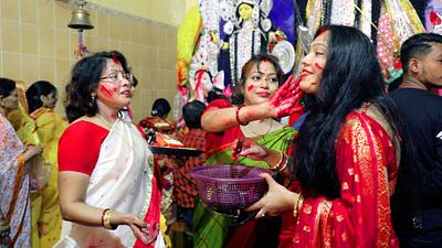 Womens celebrating durga puja