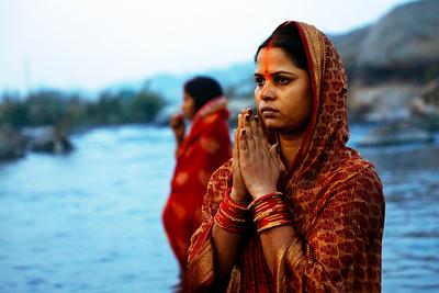 Women worshipping lord sun during chhath puja