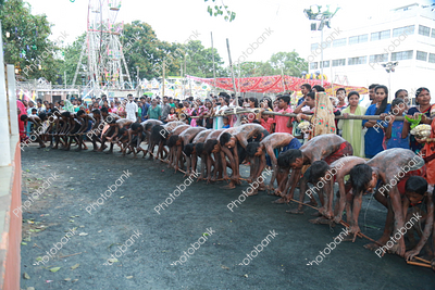 Devotees line up to celebrate manda pooja