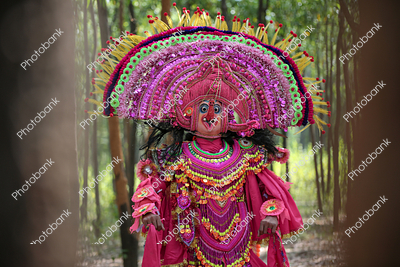 Portrait of a Chhau dance artist wearing traditional chhau mask of lord ganesha