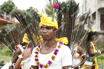 tribal boy getting ready for mundari dance during karma celebration in ranchi, jharkhand
