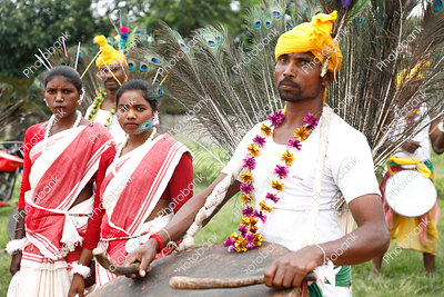 tribal dancers getting ready for mundari dance during karma celebration in ranchi, jharkhand
