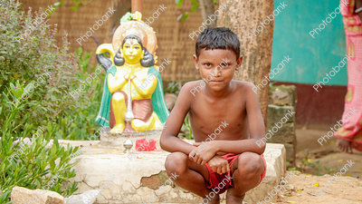 Village Boy Sitting near temple