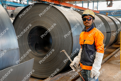 Man Standing near Steel Rools