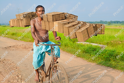 Man transporting bricks