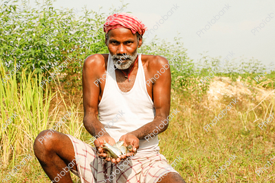Indian Man with Fish in Hand