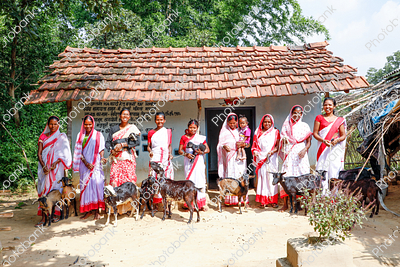 Village Women Standing near house with their goat