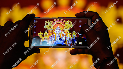 People clicking photos in Ganesh puja