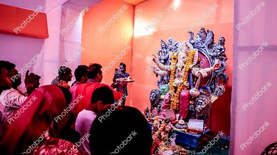 People doing aarti in Ganesh puja