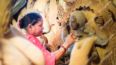 Female artisans making maa durga idol