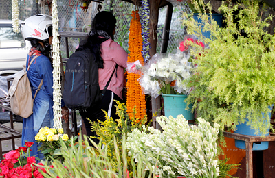 People buying flower from shop